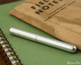 Kaweco Liliput Fountain Pen - Silver - Closed on Notebook