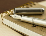 Kaweco Liliput Fountain Pen - Silver - Open on Notebook