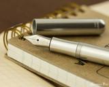 Kaweco Liliput Fountain Pen - Silver - Open on Notebook