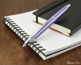 Pilot Vanishing Point Decimo Fountain Pen - Purple - Open on Notebook