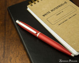 Sheaffer VFM Ballpoint - Excessive Red - On Notebook
