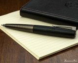 Faber-Castell Loom Ballpoint - Gunmetal Matte - Open on Notebook