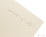 Kobeha Graphilo Notebook - A5, Lined - Ivory logo