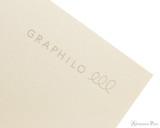 Kobeha Graphilo Notebook - A5, Lined - Ivory logo