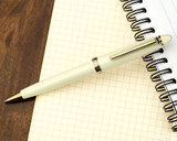 Sailor 1911 Standard Ballpoint - Ivory with Gold Trim - On Notebook
