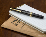 Pilot E95S Fountain Pen - Black - Closed on Notebook