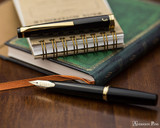 Pilot E95S Fountain Pen - Black - Open on Notebook