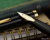 Pilot E95S Fountain Pen - Black - Nib on Notebook