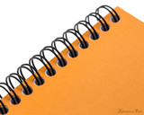 Rhodia No. 16 Wirebound Notepad - A5, Dot Grid - Orange wire detail