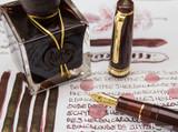 J. Herbin 1670 Anniversary Caroube de Chypre Ink ThINK Thursday bottle and pen closeup