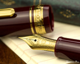 Sailor 1911 Standard Fountain Pen - Maroon with Gold Trim - Nib on Notebook