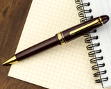 Sailor 1911 Large Ballpoint - Maroon with Gold Trim - Open on Notebook