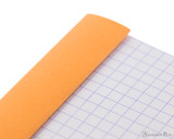 Rhodia No. 13 Staplebound Notepad - A6, Graph - Orange perforations