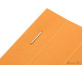 Rhodia No. 13 Staplebound Notepad - A6, Graph - Orange staple detail