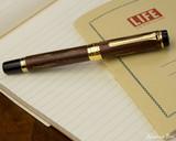 Sailor Kabazaiku Fountain Pen - Cherry Bark, Medium Nib - Closed on Notebook