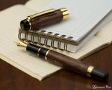 Sailor Kabazaiku Fountain Pen - Cherry Bark, Medium Nib - Open on Notebook