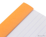 Rhodia No. 13 Staplebound Notepad - A6, Lined - Orange perforations