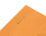 Rhodia No. 13 Staplebound Notepad - A6, Lined - Orange staple detail