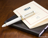 Sailor 1911 Large Fountain Pen - White with Gold Trim - Closed on Notebook