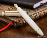 Sailor 1911 Large Fountain Pen - White with Gold Trim - Open on Notebook