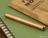 Kaweco Liliput Fountain Pen - Copper - Closed on Notebook