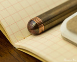 Kaweco Liliput Fountain Pen - Copper - Barrel End on Notebook