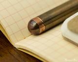 Kaweco Liliput Fountain Pen - Copper - Barrel End on Notebook
