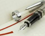 TWSBI Vac Mini Fountain Pen - Smoke - Nib on Notebook