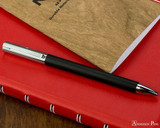 Faber-Castell Ambition Ballpoint - Black - On Notebook