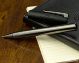 Faber-Castell Loom Rollerball - Gunmetal Polished - Open on Notebook