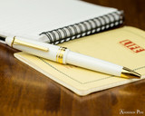 Sailor 1911 Large Ballpoint - White with Gold Trim - on Notebook