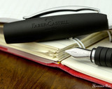 Faber-Castell Essentio Black Leather Fountain Pen - Nib on Notebook
