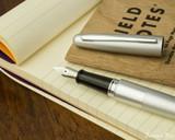 Pilot Metropolitan Fountain Pen - Silver Plain - Open on Notebook