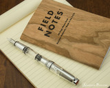 TWSBI Mini AL Fountain Pen - Silver - Closed on Notebook