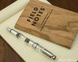 TWSBI Mini AL Fountain Pen - Silver - Closed on Notebook