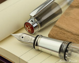 TWSBI Mini AL Fountain Pen - Silver - Nib on Notebook