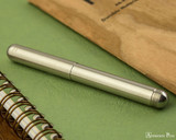 Kaweco Liliput Fountain Pen - Stainless Steel - Closed on Notebook