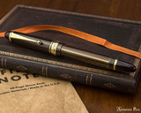 Pilot Custom 823 Fountain Pen - Amber - Closed on Notebook