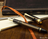Pilot Custom 823 Fountain Pen - Amber - Open on Notebook