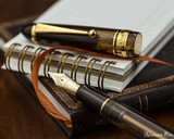 Pilot Custom 823 Fountain Pen - Amber - Nib on Notebook