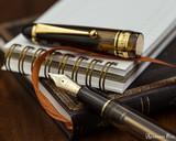 Pilot Custom 823 Fountain Pen - Amber - Nib on Notebook