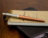 Parker Jotter Ballpoint - Chelsea Orange - On Notebook