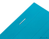 Rhodia No. 16 Premium Notepad - A5, Lined - Turquoise staple detail