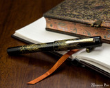 Namiki Chinkin Fountain Pen - Silver Grass - Closed on Notebook