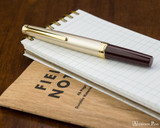 Pilot E95S Fountain Pen - Burgundy and Ivory - Closed on Notebook