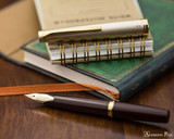 Pilot E95S Fountain Pen - Burgundy and Ivory - Open on Notebook