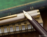 Pilot E95S Fountain Pen - Burgundy and Ivory - Nib on Notebook