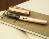 Lamy LX Fountain Pen - Rose Gold - On Notebook Open