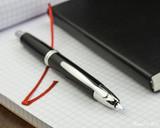 Pilot Vanishing Point Fountain Pen - Black with Rhodium Trim - Open on Notebook