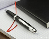 Pilot Vanishing Point Fountain Pen - Black with Rhodium Trim - Open on Notebook